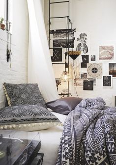 White washed brick walls. Black and white textiles.
