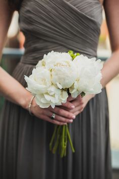 white peony bouquet, photo by Chaz Cruz http://ruffledblog.com/soho-wedding-with-modern-and-industrial-touches #peonies #weddingbouquet
