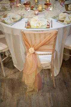 Limewash chiavari chair with a hand tied dusky pink and gold organza sash