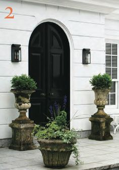 Robert Couturier's garden in CT. Love the white house with all doors lacquered in black.
