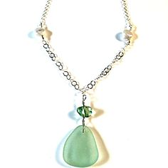 Pretty sea foam green sea glass necklace accented with green flourite and keishi pearls.