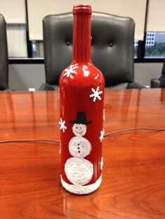 Wine bottle. Sprayed bottle red, hand painted snowman with acrylic paint mixed with Snow-Tex for texture. Add snowflakes sequins with hot glue.