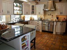 Tri Color Kitchen- All pics are property of Merri Interiors, Inc.  http://Merriinteriors.com  Three cabinet colors, terra cotta floor, SS appliances, AGA stove, chalk board and more!