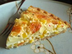 Fresh Corn Quiche from Food.com:   I love fresh corn, cornbread, creamed corn casseroles and corn chowder..so how excited could I be about a corn quiche!  Yum!   I serve this as a side dish with pork chops or ham.  I usually  leave the sugar out if corn is sweet.