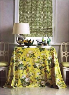 Puddled fabric over a rectangular table - chintz floral and herrinbone quadrille fabrics