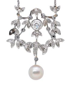 A Belle Époque Natural Pearl and Diamond Pendant Necklace, circa 1910.  Suspending a button-shaped natural pearl, topped by a bezel-set old mine-cut diamond weighing approximately 0.65 carat, amid rose-cut diamond foliage, mounted in platinum, joined to a later added 18k white gold fine trace linking necklet, length 16 ins