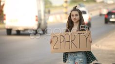 hitchhiking young adult woman hitchhiker holding 2 party written board - Stock Footage | by ionescu  #hitchhiker #party #stockfootage #pond5