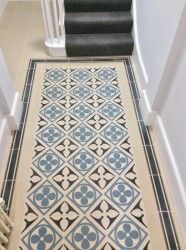 The Odyssey Quatrefoil in the traditional combination of black and blue with the black border tile.