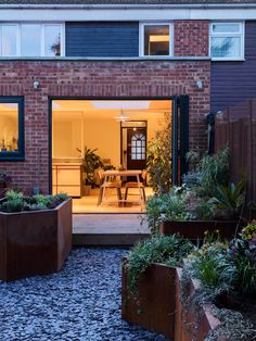 """South London studio Jailmake has redesigned this once """"ill-functioning"""" 1960s house in Peckham by opening up the kitchen and dining area to its garden"""