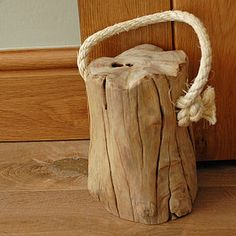 Tree stump doorstop- weathered white paint, attach 2 or 3 of varying sizes. Attach rubber to bottom to prevent floor scratches.