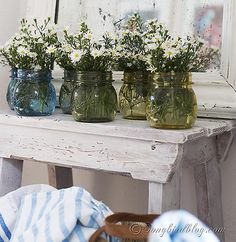 How to permanently paint glass jars to turn them into vases and add an ombre effect for extra beauty. via www.songbirdblog.com