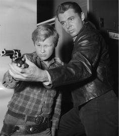NIGHT PASSAGE (1957) - Audie Murphy gives Brandon deWilde a shooting lesson between scenes - Universal-International - Publicity Still.