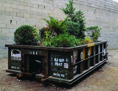 Michael Bernstein's been pushing for New Yorkers to adopt these rubbish-bin gardens for more than a decade, after having exhibited a prototype in 2001 at Long Island City's Sculpture Center. He developed the idea while living in Dumbo, where he operated a rooftop garden and a sidewalk vegetable stand amid a colorless thicket of buildings and overpasses.