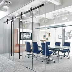 Glass conference rooms Frameless Ofs Designed Their Glasswalled Conference Rooms To Have Two Wide Entries The Ragnar Sliding Door Hardware Means The Space Wont Affect Room Flow And Can Alamy Glass Walled Conference Rooms