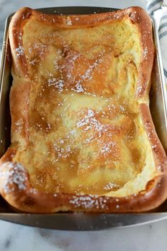 A metal inch pan with baked german pancakes in it, sprinkled with powdered sugar and syrup. A metal inch pan with baked german pancakes in it, sprinkled with powdered sugar and syrup. Pancake Recipe Taste, German Pancakes Recipe, Pancake Recipes, Pancake Toppings, German Waffle Recipe, Simple Pancake Recipe, Crepe Pancake Recipe, Mini German Pancakes, German Apple Pancake