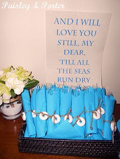 quote and wrapped silverware for nautical themed baby shower