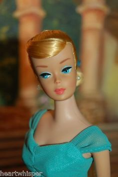My first Barbie was a 1961 Swirl Ponytail just like this one.  I still have her in mint condition, except for the original clothes.