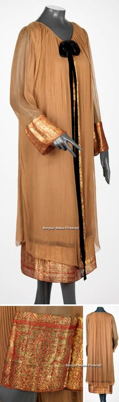 Afternoon ensemble, Callot Soeurs (attr.), 1923. Pleated silk, leno weave with red and gold metallic brocade, and black velvet trim. Toffee-colored afternoon dress, tightly pleated at neckline, features billowing sleeves and deep hem of red and gold brocade. Chiffon overdress floats away from the figure, with cuffs and center front closure bound with same brocade as hem. Via Rhode Island School of Design. Museum
