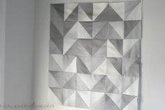 If you're looking to make an inexpensive baby gift… this quilt is perfect for you. It can easily be created in an afternoon.I was inspired by Vanessa Christenson'sombré baby quilt and decided I wanted to make a similar one with half-square triangles. I love how it ended up looking like anombré chevron.. kind of on…