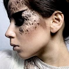 Take a piece of lace and secure with medical tape or have a friend help hold it....then apply creme/powder shadow over lace. Remove lace to reveal the awesomeness!!!!!! Great Halloween makeup idea or just having fun with photos!