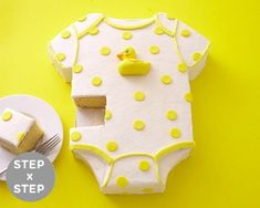 Our Ducky Onesie Cake is the perfect baby shower cake for a gender neutral party. Lean how to make it with our step by step photo tutorial.  Cakegirls Tutorials