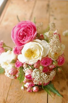 White rice flower with spray roses and standard roses in cream and pink. #bouquet
