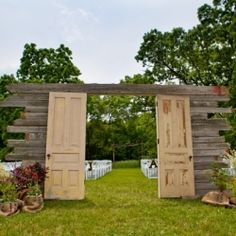 A rustic door welcomes a wedding ceremony...Vintage details at this barn wedding in Illinois. (Great idea if we do the wedding out at my parents house in the country... that way I'm hidden from view :) )