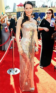 Lucy Liu at Emmys 2012 in Versace's contoured metal (yes, metal!) gown was worked to perfection by Lucy Liu who paired her design with diamond earrings and a gold roll clutch