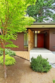 Simple Statement Exterior | mid-century MODERN LOVE Very similar to the exterior/style of our home.  Like the plain front, colorful door.