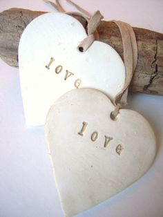 love hearts tied with leather strands