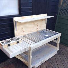 My new mud kitchen. Make the shelf deeper for 2 water jugs and have a gravity working sink