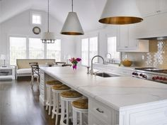 white kitchen with marble and vaulted ceiling by deirdre