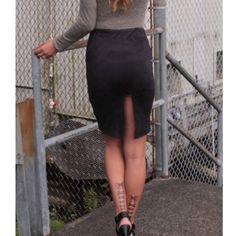 High slit skirt Soft suede stretch black skirt. Available in small medium  and large Solemio Skirts