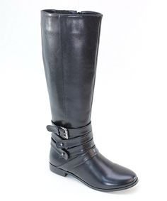 Keep feet covered in fashion with these long and lovely boots. A side zipper seals this pair shut, while four decorative straps wind their way around the bottom for a sleek and subtle style.16'' shaft15'' circumferenceSide zipper closureMan-madeImpo...