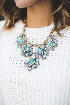 White cable knit sweater and statement necklace
