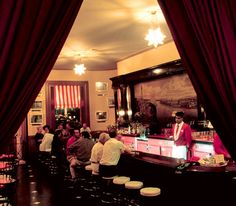 """The Floridita bar // Havana, Cuba. The cradle of the daiquiri. Named by Esquire one of the """"World's Seven Greatest Bars"""" in 1957. In 2011, Esquire's update noted: """"[T]he true measure of a great bar...is whether it can create its own little universe where for a little while life outside seems very far away. The Floridita has been doing it for more than 100 years."""""""