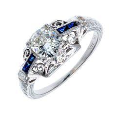 Art Deco Sapphire Diamond Platinum Ring. All original Art Deco Platinum Edwardian ring circa 1910 to 1920. Nice filigree work, European cut side diamonds, calibre cut Sapphires. EGL certified top quality G, VS2 bright sparkly center diamond. c 1910-1920