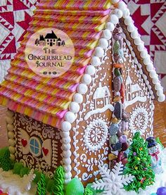 gingerbread house for Christmas. look at the piping of a tiny winter scene! www.gingerbreadjournal.com
