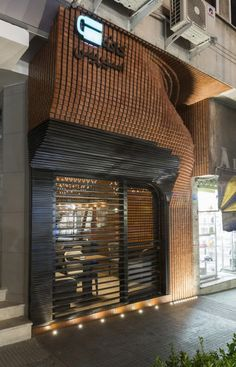 Awesome entrance, over did it in the inside. #interiors #cafedesign © Parham Taghioff