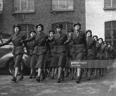 Members of the Mechanised Transport Corps on parade. They are responsible for driving war time forces such as stretcher bearers and replace male drivers wherever necessary. Original Publication: Picture Post - Women's Army for Britain - pub. 1940