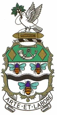 """Blackburn coat of arms. Argent a Fesse wavy Sable between three Bees volant proper on a Chief Vert a Bugle stringed Argent between two Fusils Or. On the crest, a Wreath of the Colours a Shuttle Or thereon a Dove wings elevated Argent and holding in the beak the Thread of the Shuttle reflexed over the back and an Olive Branch proper. The Latin motto of the town is Arte et Labore, correctly translated as """"by art and by labour"""" but often translated as """"by skill and hardwork""""."""