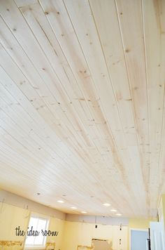 We used V groove, Pine Wood Planks from Lowe's. They were pretty inexpensive f. - We used V groove, Pine Wood Planks from Lowe's. They were pretty inexpensive for a pack of six, 8 - Wood Plank Ceiling, Porch Ceiling, Wooden Ceilings, Plank Walls, Wood Planks, Wood Walls, Basement Ceilings, Basement Bars, Vaulted Ceilings