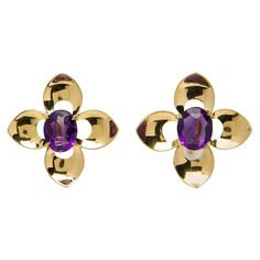 Tiffany & Co. Retro Amethyst and Gold Earrings   From a unique collection of vintage clip-on earrings at https://www.1stdibs.com/jewelry/earrings/clip-on-earrings/
