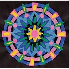 Sanded Paper Mandalas Craft. Beautiful to look  at and fun to make. Instructions on www.freekidscrafts.com