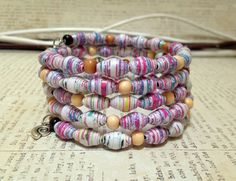 Handmade Paper bead bracelet Silver charms Bangle by JoannaJeanne