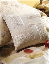 This is an upcycled wedding dress into a lacy patchwork pillow, but the four squares could be any material. I like how they meet in the middle.