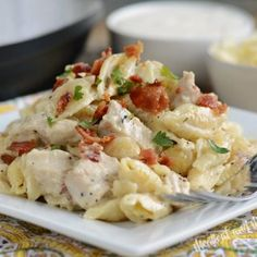 instant pot creamy chicken bacon ranch pasta on plate with parsley