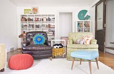 "An eclectic family home in Springfield, MO: ""Almost all of the furniture in our living room was thrifted, flea marketed, garage saled… you get the picture! The bookcases are from Ikea and the little round metal side tables are from Urban Outfitters. The big rug was from a Pottery Barn outlet and was thoroughly doused with Scotch Guard before we brought it in."" #sneakpeek"
