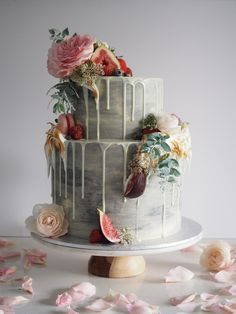 The Hottest Trend in Wedding Desserts: Drip Cakes | Cake That Looks Like It's Straight Out of a Renaissance Painting | Blue White Ombre Watercolor Cake dripping with white icing and topped with florals and fruit