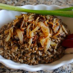 Mujadara is a meatless Lebanese dish made with lentils and rice. It was  traditionally eaten during Lent when many were fasting from meat. It's also commonly eaten all year round on Fridays (a day...